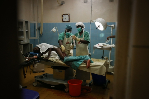 Operating theatre staff prepare a 20-year-old man for surgery, at the MSF supported hospital in Masisi, North Kivu, DRC. The man had been wounded by gunfire during intense fighting in Nyabiondo, a town in the Masisi area where MSF is supporting the health center.