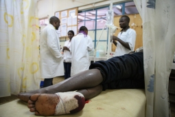 Emergency room in Masisi hospital, North Kivu, DRC. The man had been wounded by gunfire during intense fighting in Nyabiondo, a town in the Masisi area where MSF is supporting the health center.